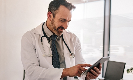 Doctor signing up for CareClix on a tablet